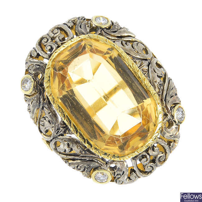 A citrine and diamond ring.