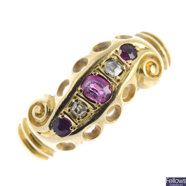 An Edwardian 18ct gold ruby and diamond dress ring.