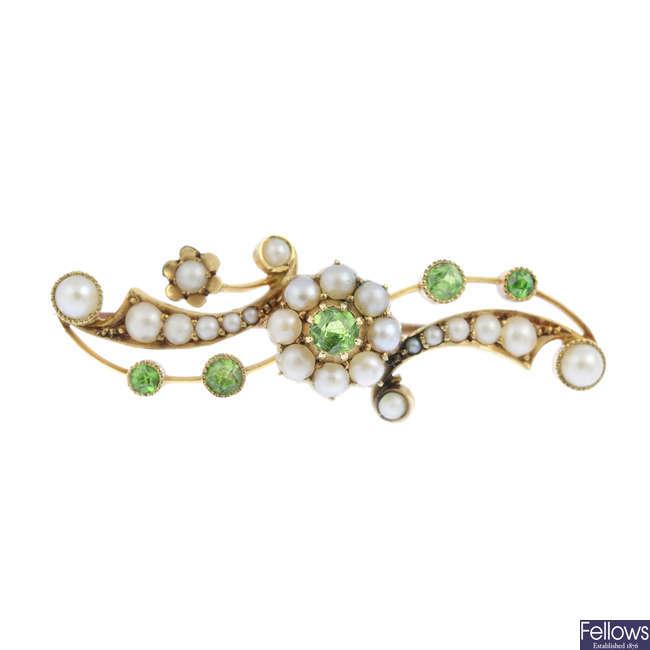 An early 20th century 15ct gold demantoid garnet and split pearl brooch.
