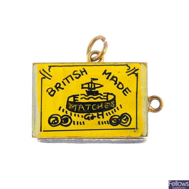 A mid 20th century 9ct gold matchbox charm.