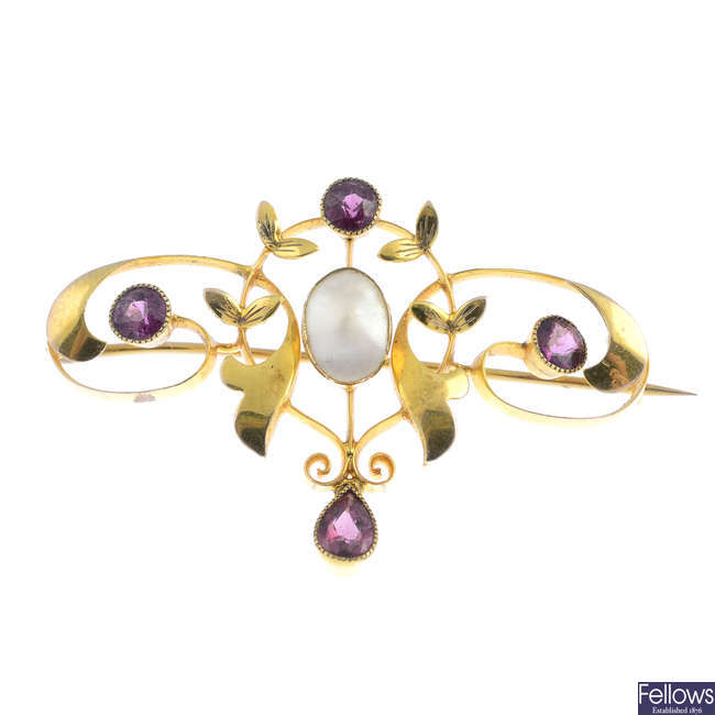 An early 20th century 9ct gold garnet and mother-of-pearl brooch.