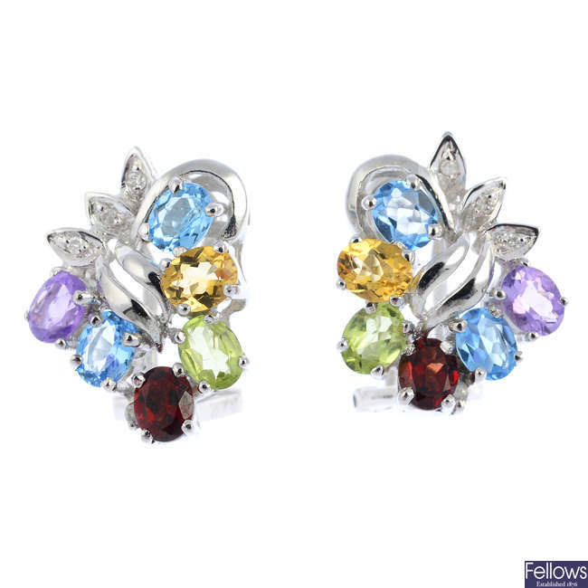 A pair of 14ct gold diamond and gem-set earrings.