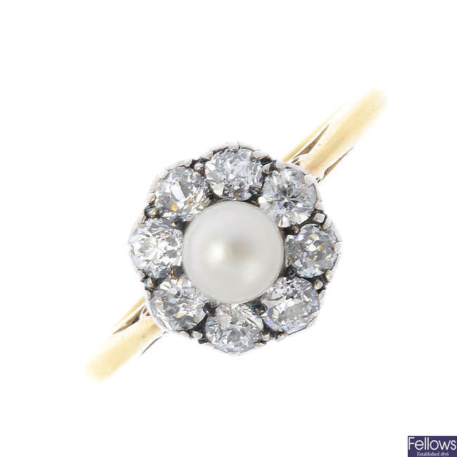 An early 20th century silver and 18ct gold pearl and diamond cluster ring.