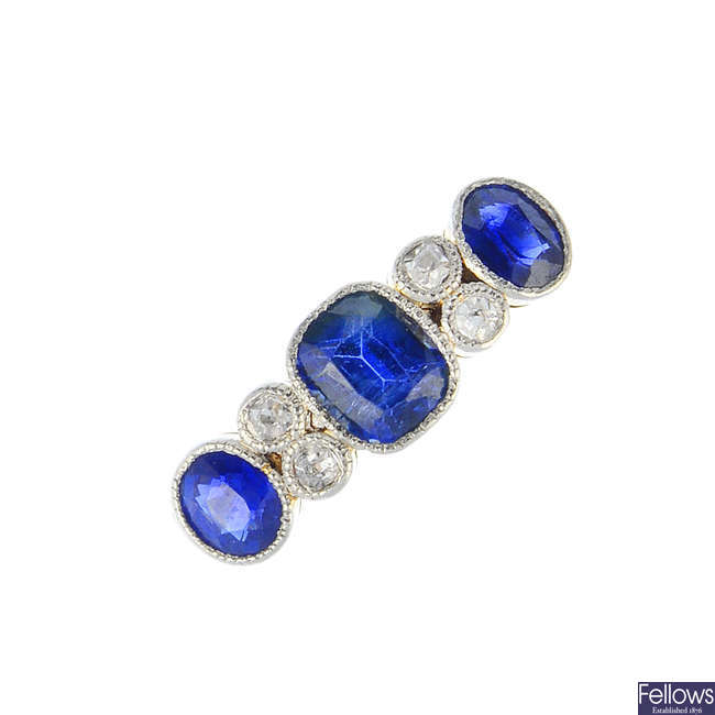 An early 20th century 18ct gold sapphire and diamond dress ring.