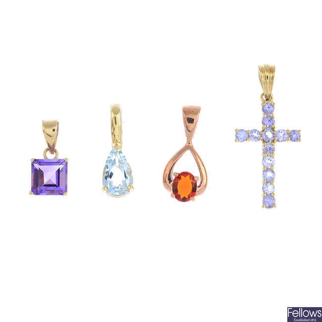 Four gem-set pendants.