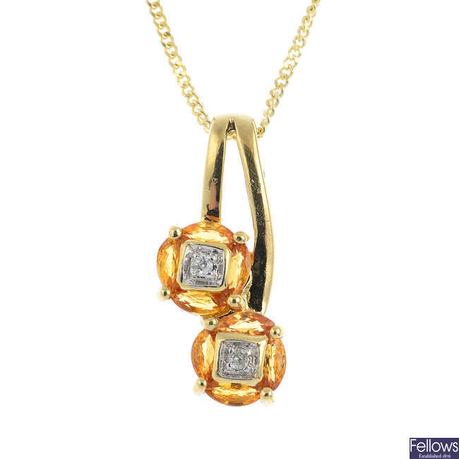 A 9ct gold diamond and citrine pendant, with 9ct gold chain.