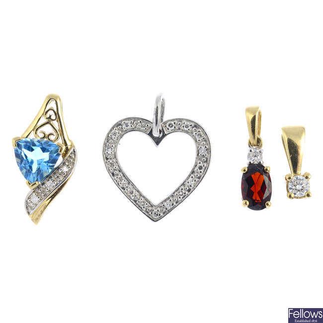 Four diamond and gem-set pendants.