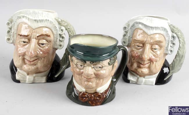 Five Royal Doulton character mugs.