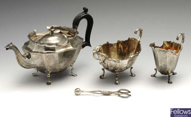 A cased late Victorian silver bachelor three piece tea set and a pair of silver scissor action sugar nips.