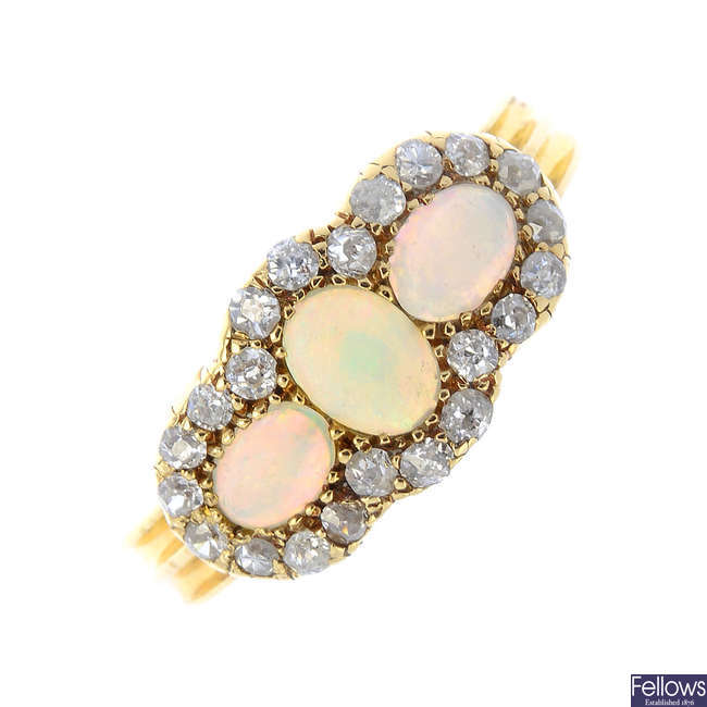 A late Victorian 18ct gold opal and diamond cluster ring.