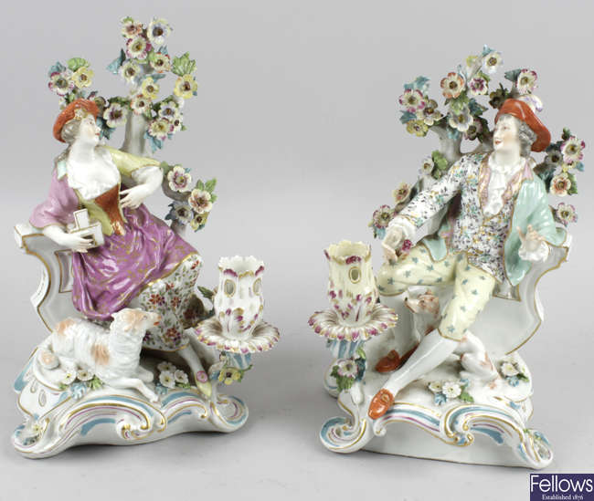 A pair of continental porcelain figure groups.