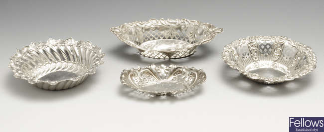 A late Victorian silver dish, plus three silver pierced dishes. (4).
