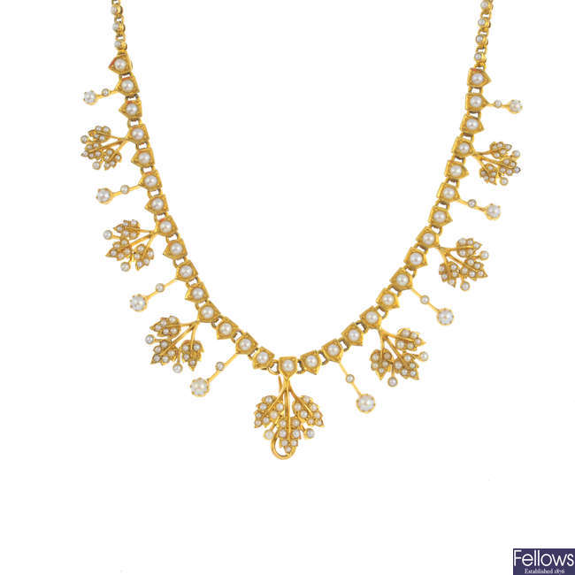 An early 20th century gold split pearl necklace.