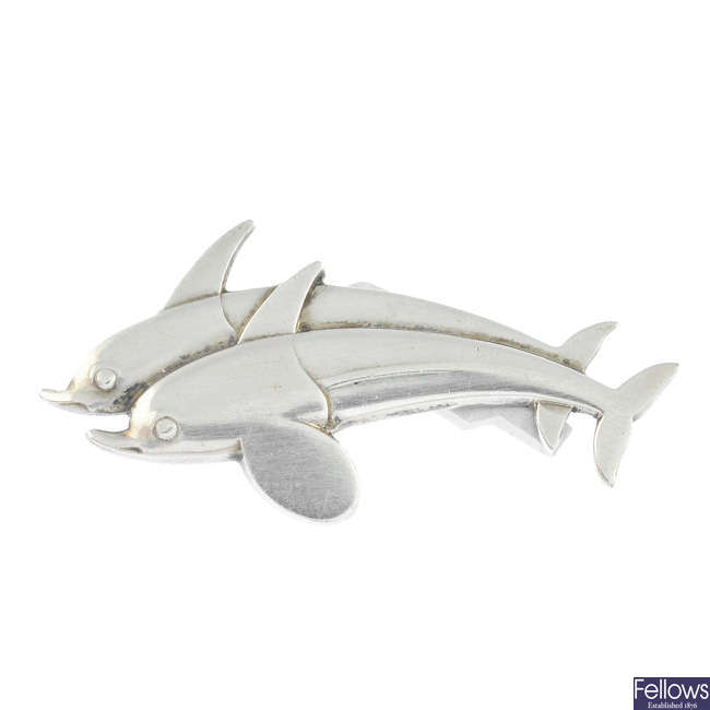 GEORG JENSEN - a silver twin dolphin or fish brooch, no. 317.