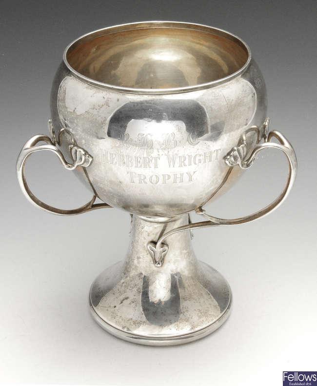 An Edwardian Art Nouveau silver tyg.