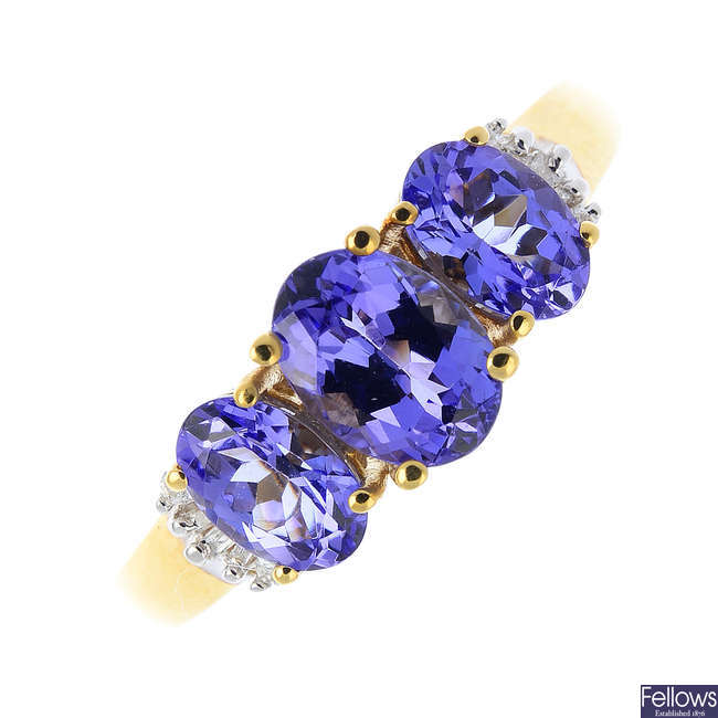 An 18ct gold tanzanite and diamond three-stone ring.