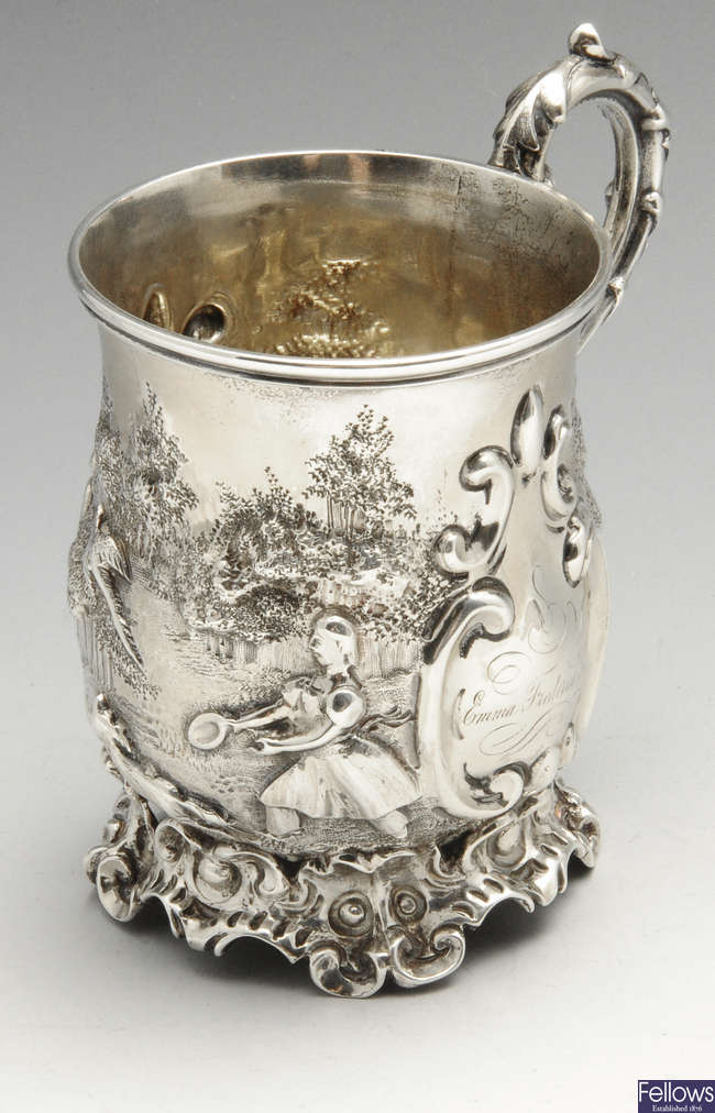 An early Victorian embossed silver christening mug.