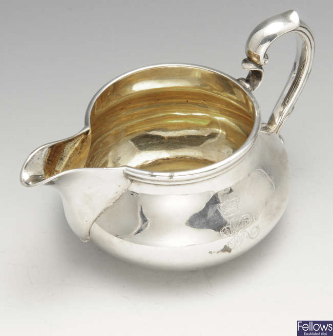 A Victorian silver cream jug by Garrard, bearing the royal cypher for Queen Victoria.