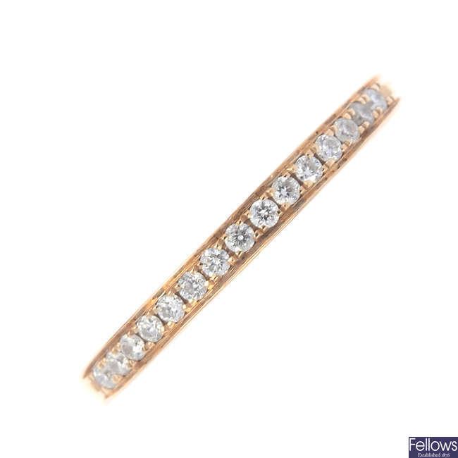 An 18ct gold diamond half eternity ring.