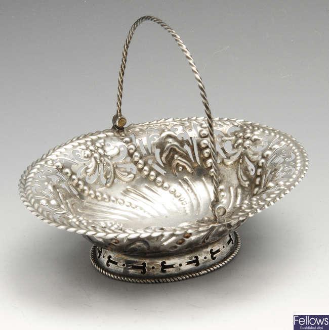 A George III silver swing-handled bonbon dish.