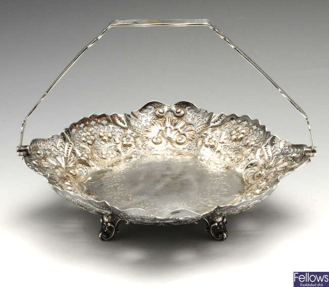 A Victorian silver pierced & embossed dish with swing handle.