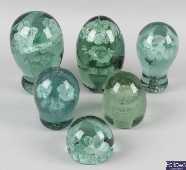 A collection of fifteen assorted Victorian and later green glass paperweights.