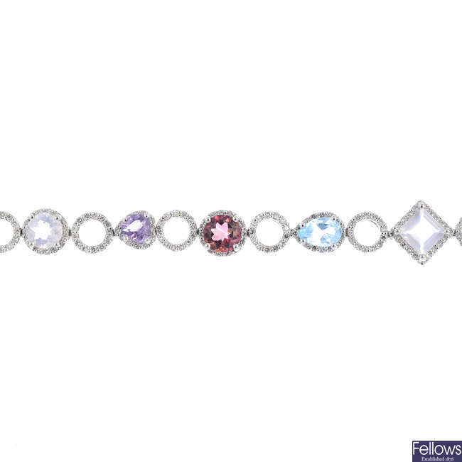 An 18ct gold diamond and gem-set bracelet.