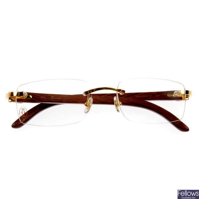CARTIER - a pair of C Decor rimless glasses.