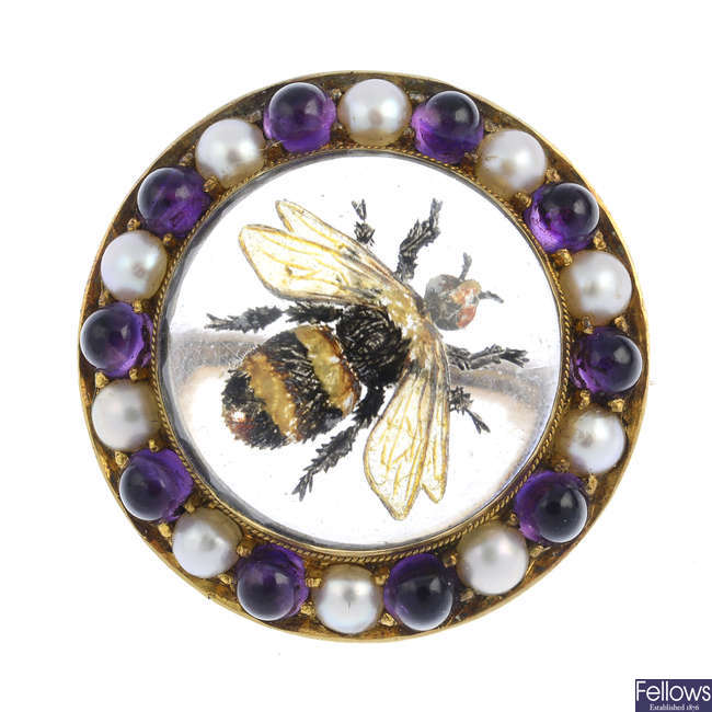 CARLO GIULIANO - a late Victorian 18ct gold amethyst and split pearl reverse-carved intaglio bumble bee brooch.