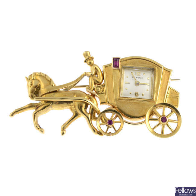 BUCHERER - a mid 20th century ruby horse and carriage watch brooch.