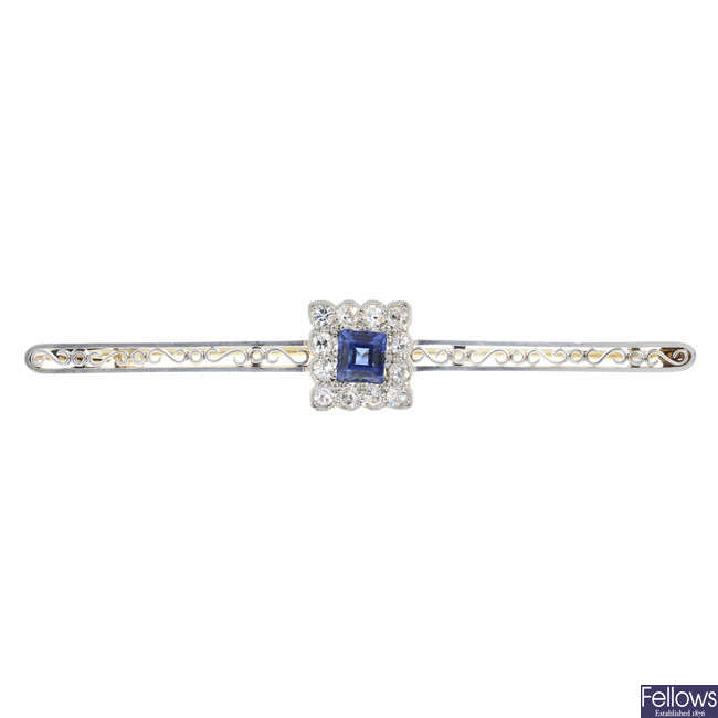 An early 20th century gold sapphire and diamond cluster bar brooch.