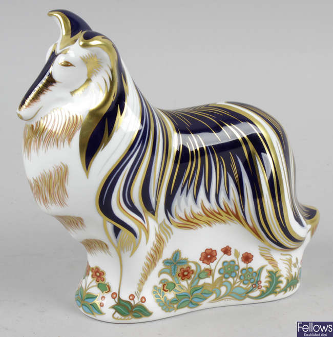 A Royal Crown Derby porcelain paperweight, modelled as a rough collie.