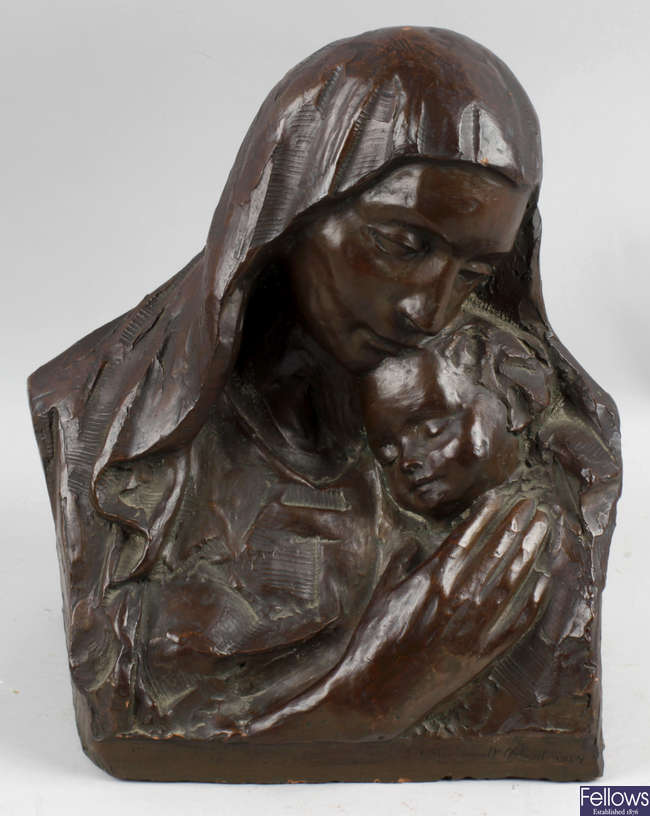 A mid 20th century terracotta bust depicting the Madonna and child.
