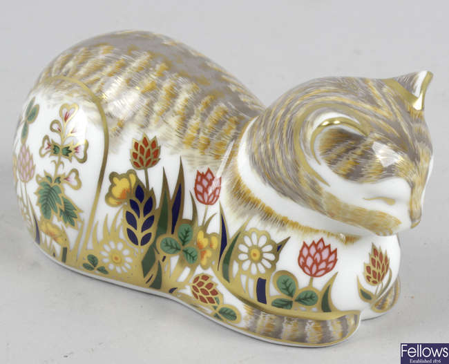 A Royal Crown Derby porcelain paperweight, modelled as clover cat.