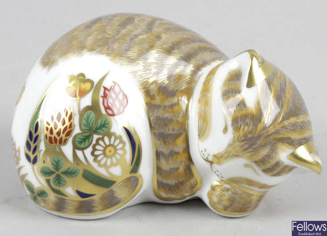 A Royal Crown Derby porcelain paperweight, modelled as lavender cat.