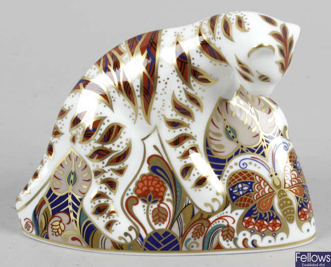 A Royal Crown Derby porcelain paperweight, modelled as a Bengal tiger cub.