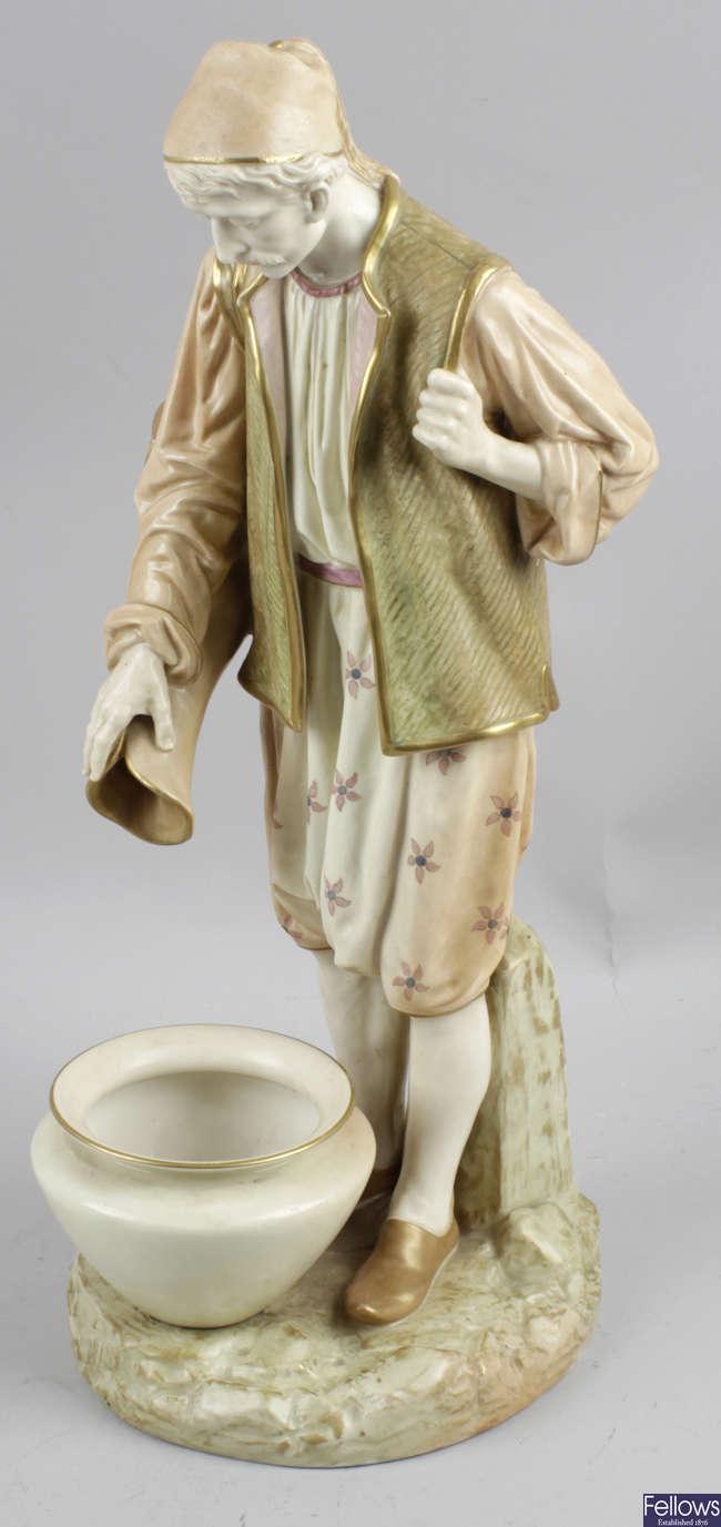A large Royal Worcester James Hadley bone china figure.
