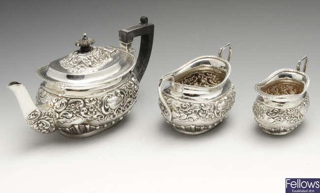 An Edwardian silver three piece bachelor tea service.