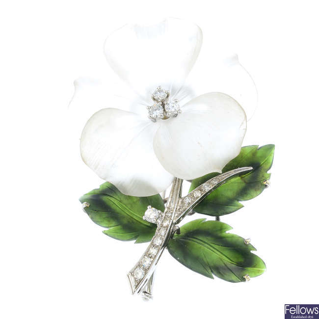 A mid 20th century rock crystal, nephrite jade and diamond floral brooch, by Knoll & Pregizer.