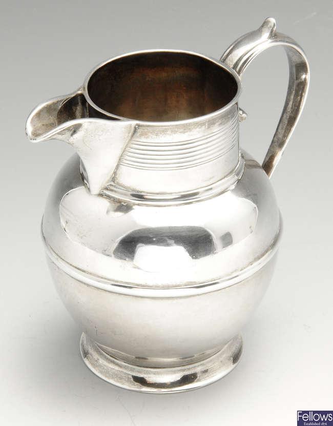 A George III small silver pitcher jug.