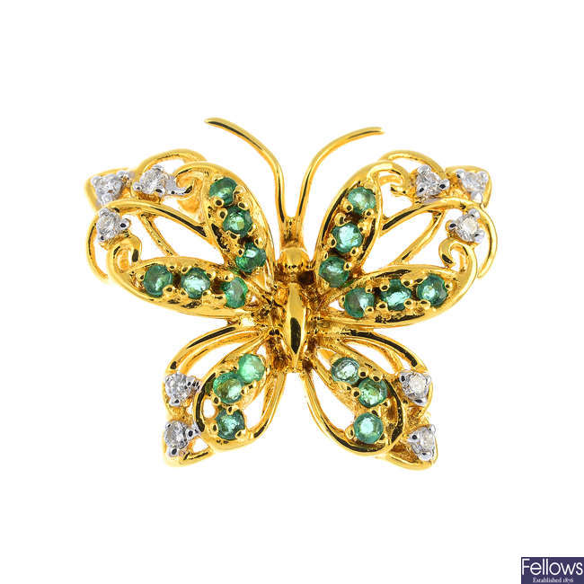 An 18ct gold emerald and diamond butterfly brooch.