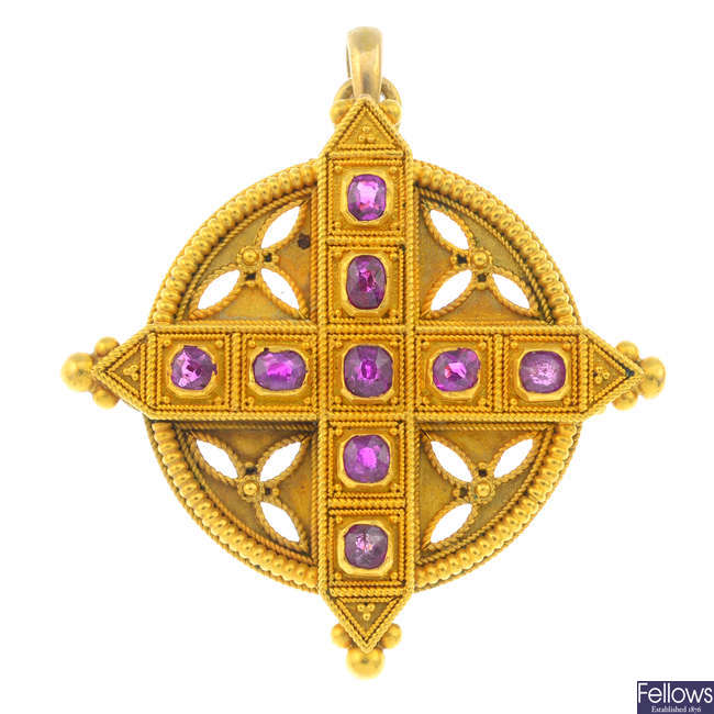 A mid Victorian Gothic Revival gold ruby pendant.