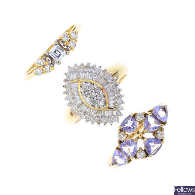 Three gold gem-set dress rings.