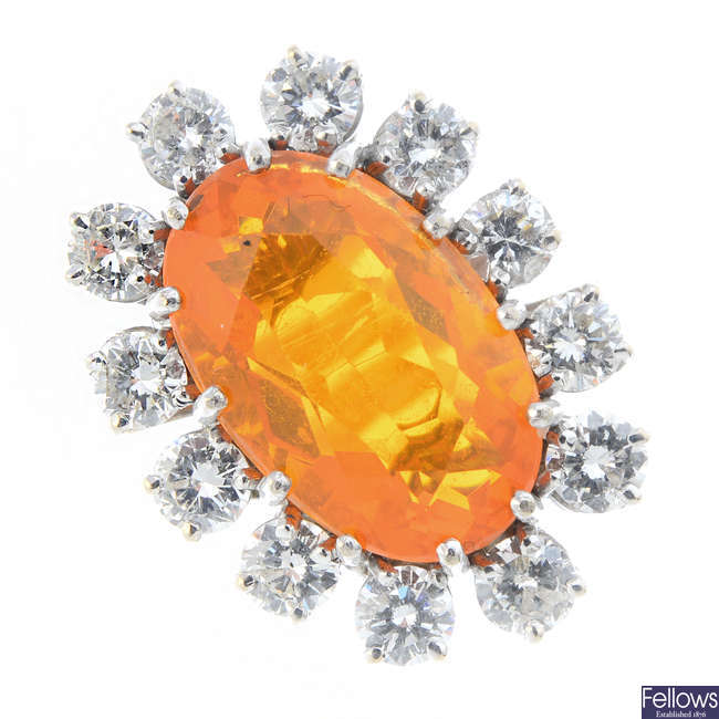 An 18ct gold fire opal and diamond cluster ring.