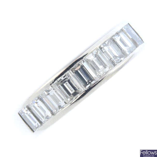 A platinum diamond half eternity ring.