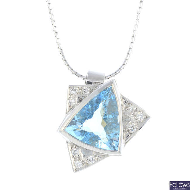 An 18ct gold aquamarine and diamond pendant, with 18ct gold chain.