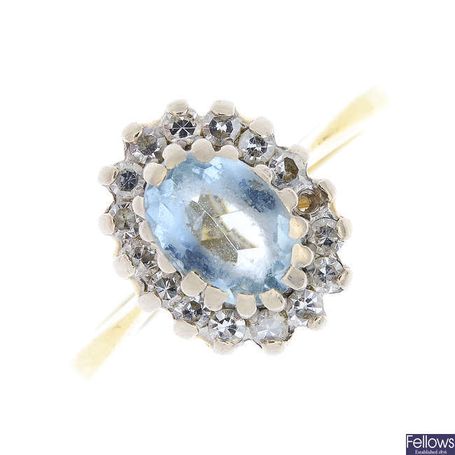 An 18ct gold aquamarine and diamond cluster ring.