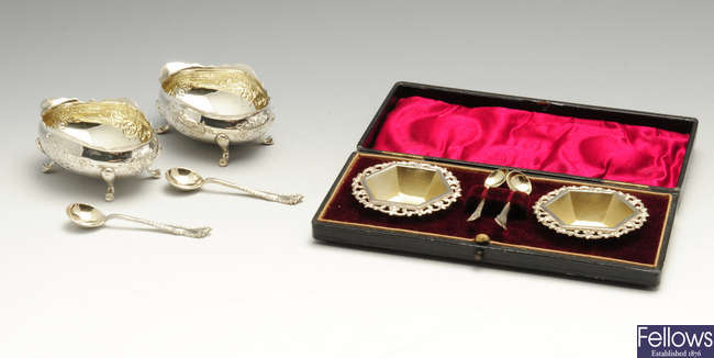 A pair of late Victorian silver open salts with spoons & a cased pair of Edwardian silver open salts with matched spoons.