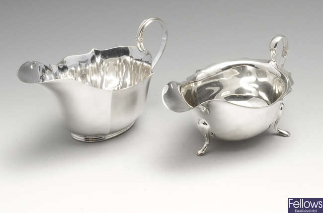 Two 1930's silver sauce boats & a 1940's small silver dish. (3).