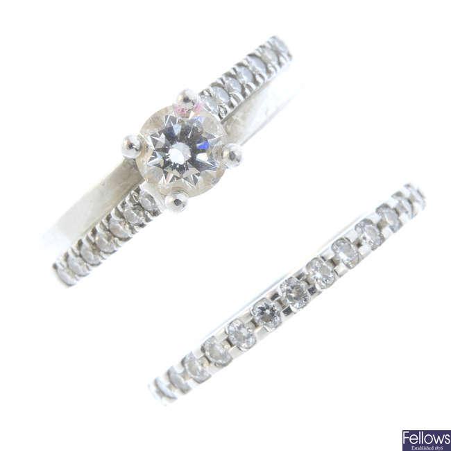 Two platinum diamond rings.